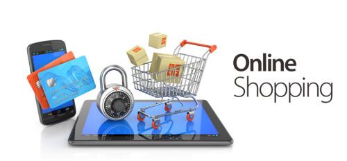 Кредитные карты, планшет и тележка для покупок